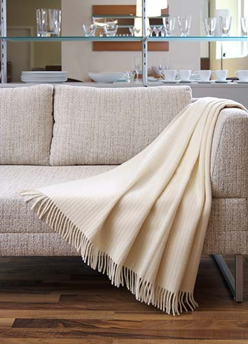 Cashmere blanket covering sofa